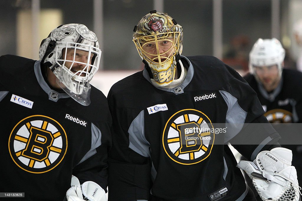 Boston Bruins goalie Tim Thomas (#30) and Boston Bruins goalie Anton Khudobin (#35) share a laugh at practice. Boston Bruins practice at the Kettler Capitals Iceplex as they prepare for game four against the Washington Capitals.