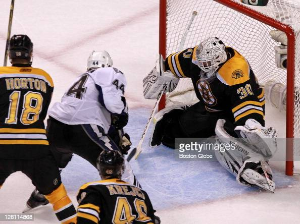 Boston Bruins goalie Tim Thomas makes a save on a point blank shot by Tampa Bay Lightning center Nate Thompson during the second period The Boston...