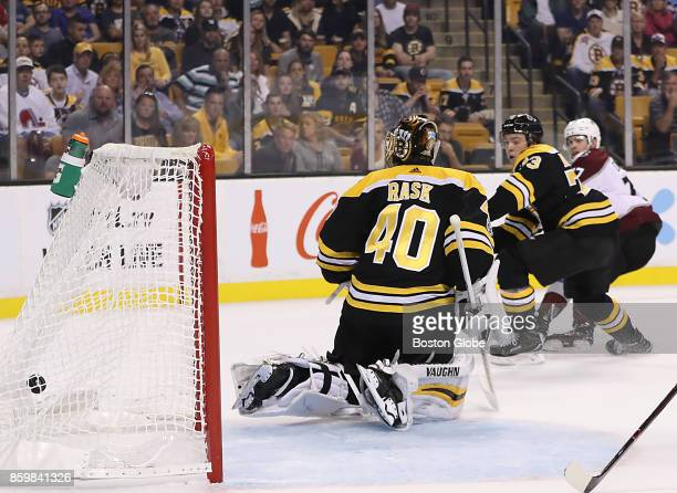 Boston Bruins goalie Tuukka Rask and defenseman Charlie McAvoy watch Colorado Avalanche left wing JT Compher's puck hit the back of the net during...