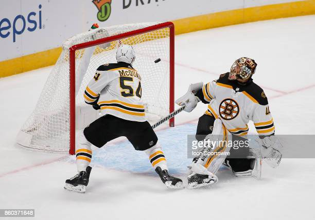 Boston Bruins goalie Tuukka Rask looks back as the puck goes into the net during a regular season game between the Colorado Avalanche and the...