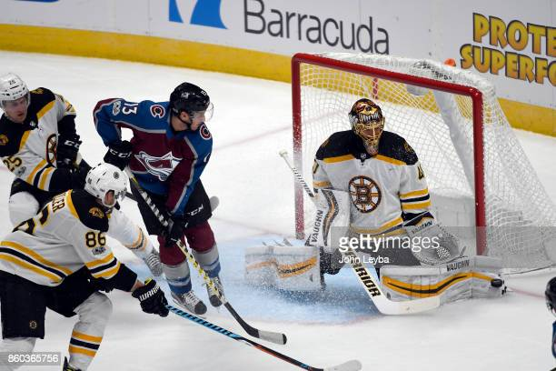 Boston Bruins goalie Tuukka Rask makes a leg pad save as Colorado Avalanche center Alexander Kerfoot looks on during the second period October 11...