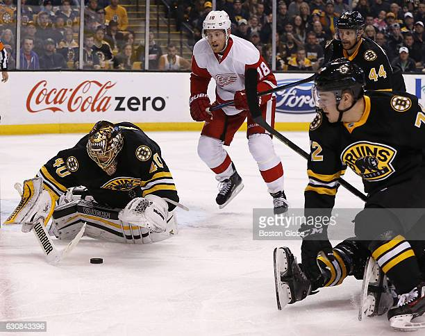 Boston Bruins goalie Tuukka Rask makes a save in front of Detroit Red Wings center Joakim Andersson during the second period The Boston Bruins host...