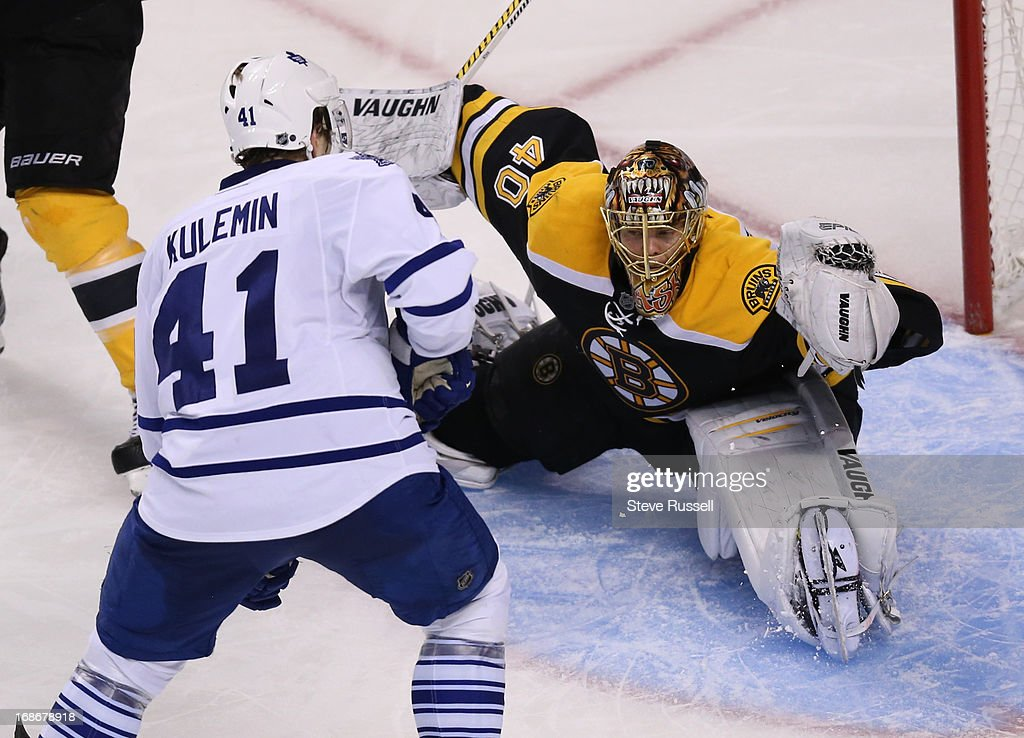 BOSTON, MA - MAY 13 - Boston Bruins goalie Tuukka Rask makes a stop as Nikolai Kulemin looks for a rebound as the Toronto Maple Leafs play the Boston Bruins in game 7 in their first round NHL Stanley Cup playoffs series at TD Garden in Boston, May 13, 2013.