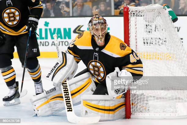 Boston Bruins goalie Tuukka Rask watches the puck along the boards during a game between the Boston Bruins and the Colorado Avalanche on October 9 at...