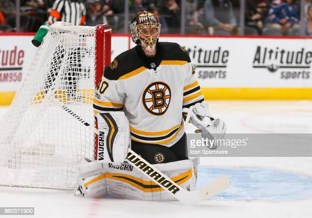 Boston Bruins goalie Tuukka Rask watches the puck during a regular season game between the Colorado Avalanche and the visiting Boston Bruins on...