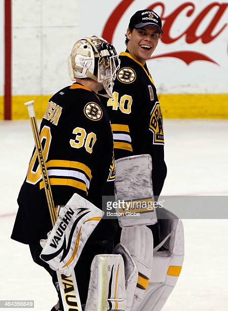 Boston Bruins goaltender Chad Johnson left is congratulated by Bruins goaltender Tuukka Rask right at the conclusion of the third period of play...