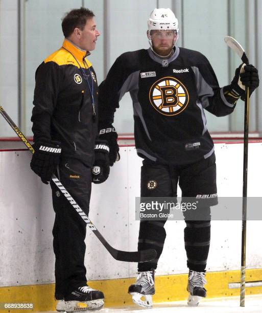 Boston Bruins head coach Bruce Cassidy talks with Boston Bruins defenseman Joe Morrow during practice in advance of Saturday's Game 2 at the Bell...