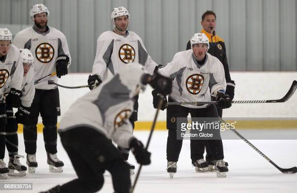 Boston Bruins head coach Bruce Cassidy watches Boston Bruins left wing Brad Marchand and the team during practice in advance of Saturday's Game 2 at...