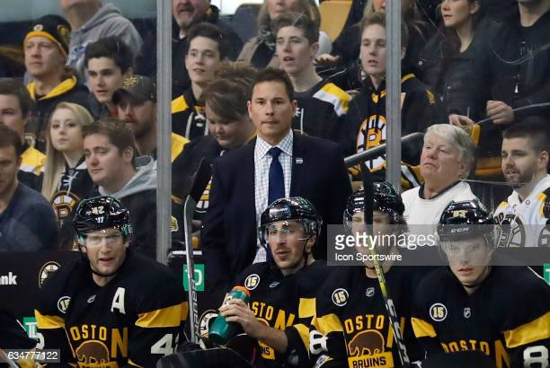Boston Bruins head coach Bruce Cassidy watches from the bench during a regular season NHL game between the Boston Bruins and the Vancouver Canucks on...