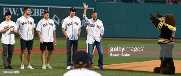 Boston Bruins head coach Bruce Cassidy waving is on hand to throw out a ceremonial first pitch on Boston Bruins night at Fenway Park From left...