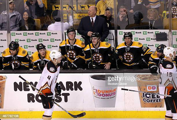 Boston Bruins head coach Claude Julien and his team wore long faces on the bench after giving up the game tying goal with 39 seconds left in the...