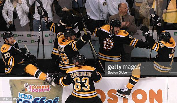 Boston Bruins head coach Claude Julien and the Boston Bruins celebrate the win The Boston Bruins took on the Tampa Lightning in Game 7 of the NHL...
