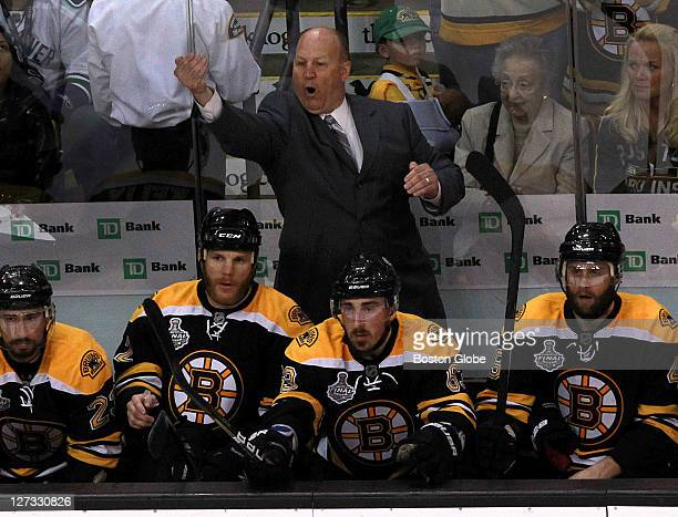 Boston Bruins head coach Claude Julien calls a play from the bench late in the 3rd period The Boston Bruins took on the Vancouver Canucks in Game 6...