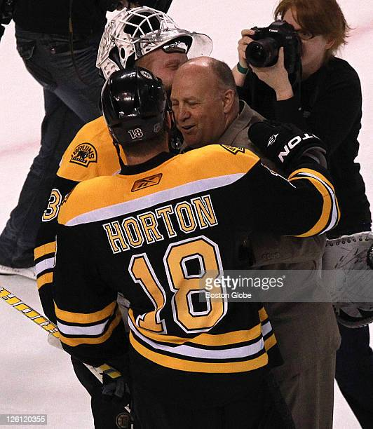 Boston Bruins head coach Claude Julien celebrates with Boston Bruins goalie Tim Thomas and Boston Bruins right wing Nathan Horton at the end of the...