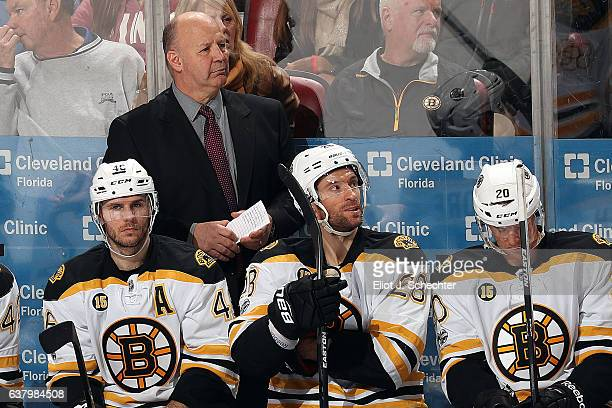 Boston Bruins Head Coach Claude Julien directs his team from the bench against the Florida Panthers at the BBT Center on January 7 2017 in Sunrise...