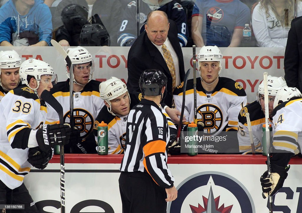 Boston Bruins' head coach <a gi-track='captionPersonalityLinkClicked' href=/galleries/search?phrase=Claude+Julien&family=editorial&specificpeople=582124 ng-click='$event.stopPropagation()'>Claude Julien</a> speaks with referee Brian Pochmara #16 in a game against the Winnipeg Jets in NHL action at the MTS Centre on December 6, 2011 in Winnipeg, Manitoba, Canada.