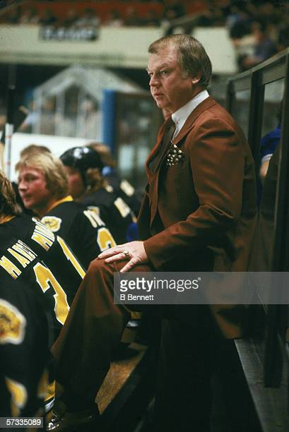 Boston Bruins head coach Don Cherry watches a game against the New York Rangers from behind the bench at Madison Square Garden New York New York 1970s