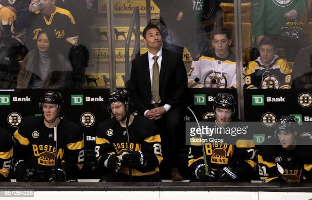 Boston Bruins Interim head coach Bruce Cassidy looks at the scoreboard after the Bruins fell behind 63 on the empty net goal by Tampa Bay Lightning...