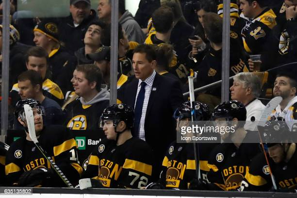 Boston Bruins interim head coach Bruce Cassidy talks with Boston Bruins right wing Jimmy Hayes during a regular season NHL game between the Boston...