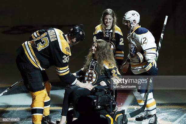 Boston Bruins left defenseman Zdeno Chara greets Denna Laing on the one year anniversary of her accident at the Winter Classic before a regular...