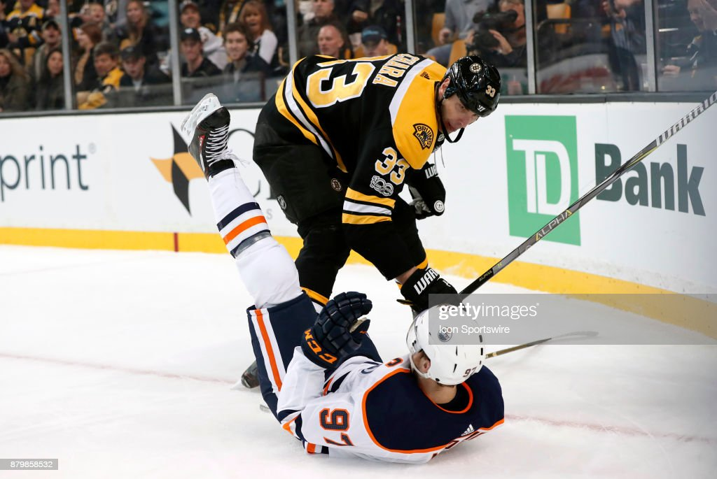 Boston Bruins left defenseman Zdeno Chara (33) keeps Edmonton Oilers center Connor McDavid (97) down during a game between the Boston Bruins and the Edmonton Oilers on November 26, 2017, at TD Garden in Boston, Massachusetts. The Oilers defeated the Bruins 4-2.