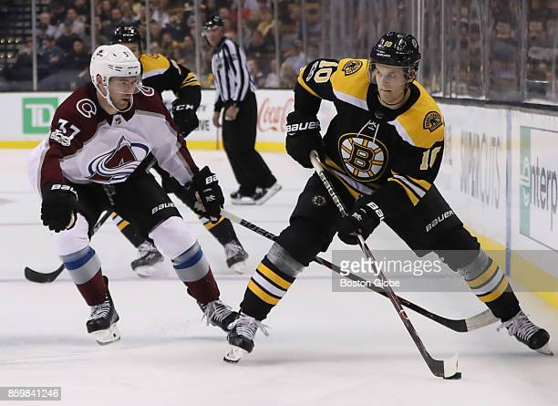 Boston Bruins left wing Anders Bjork controls the puck with pressure from Colorado Avalanche left wing JT Compher during the second period The Boston...