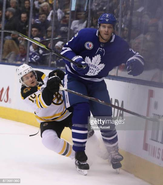 TORONTO ON NOVEMBER 10 Boston Bruins left wing Anders Bjork falls off of Toronto Maple Leafs defenseman Ron Hainsey as the Toronto Maple Leafs play...