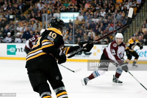 Boston Bruins left wing Anders Bjork follows through on a shot during a game between the Boston Bruins and the Colorado Avalanche on October 9 at TD...