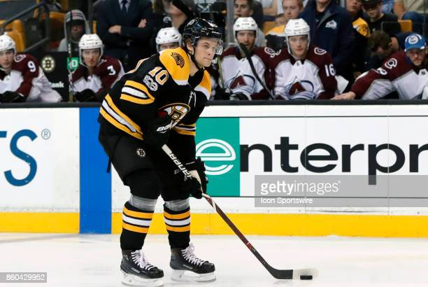 Boston Bruins left wing Anders Bjork holds the puck during a game between the Boston Bruins and the Colorado Avalanche on October 9 at TD Garden in...