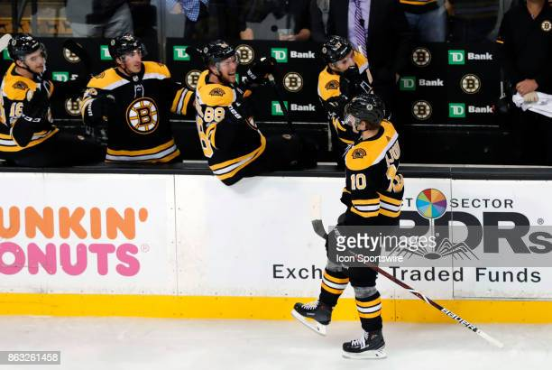 Boston Bruins left wing Anders Bjork skates by the bench after his second goal of the game during a game between the Boston Bruins and the Vancouver...