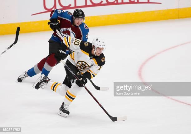 Boston Bruins left wing Anders Bjork skates toward the net as Colorado Avalanche center Matt Duchene chases during a regular season game between the...