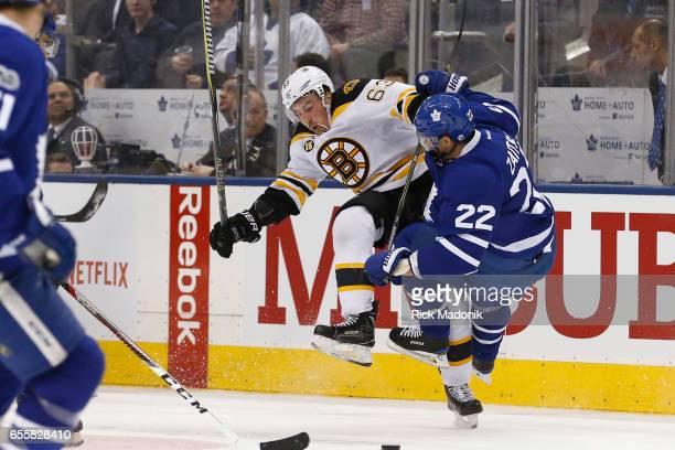 Boston Bruins left wing Brad Marchand and Toronto Maple Leafs defenseman Nikita Zaitsev collide in the neutral zone Toronto Maple Leafs VS Boston...