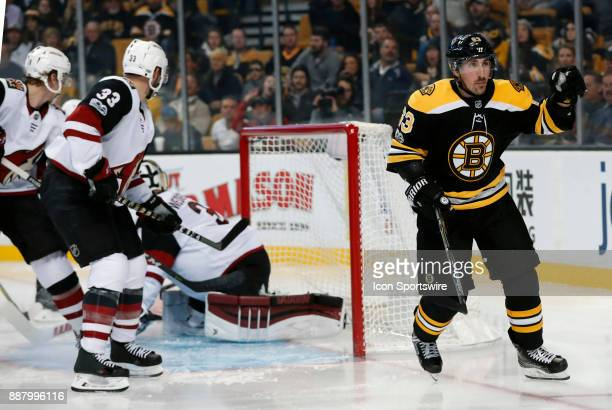 Boston Bruins left wing Brad Marchand asks for a call after being hooked down on a break away during a game between the Boston Bruins and the Phoenix...