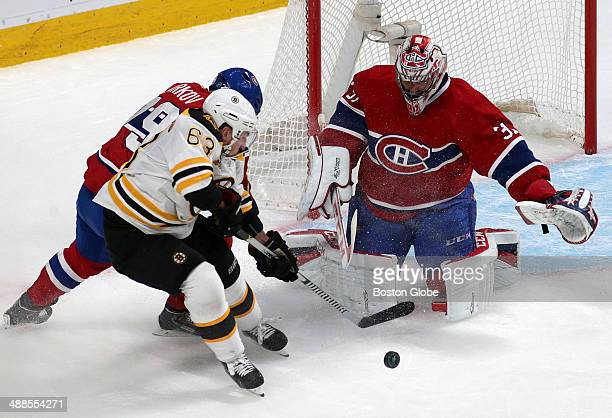 Boston Bruins left wing Brad Marchand is unable to get a shot off as he is pressured by Montreal Canadiens defenseman Andrei Markov The Montreal...