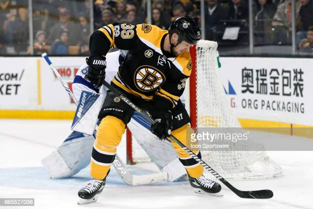 Boston Bruins left wing Matt Beleskey holds the puck down low on Tampa Bay Lightning goalie Andrei Vasilevskiy during a regular season NHL game...