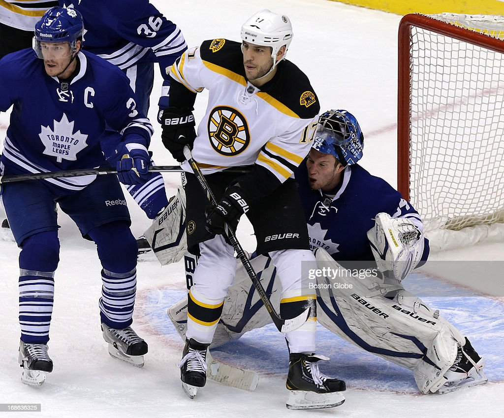 Boston Bruins left wing Milan Lucic (#17) dislodges the face mask of Toronto Maple Leafs goalie James Reimer (#34) shortly after scoring on the man advantage after the Bruins pulled Boston Bruins goalie Tuukka Rask (#40) late in the third period. The Boston Bruins take on the Toronto Maple Leafs in Game Six of the Eastern Conference Quarterfinals of the Stanley Cup Playoffs at the Air Canada Centre in Toronto.
