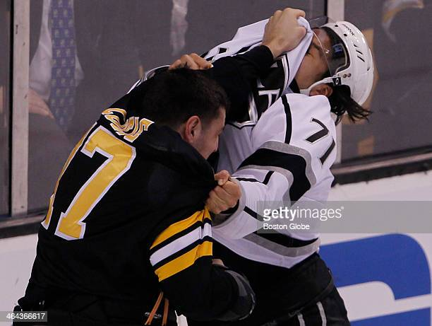 Boston Bruins' Milan Lucic left fights with Los Angeles Kings Jordan Nolan during the first period of play at TD Garden in Boston Jan 20 2014