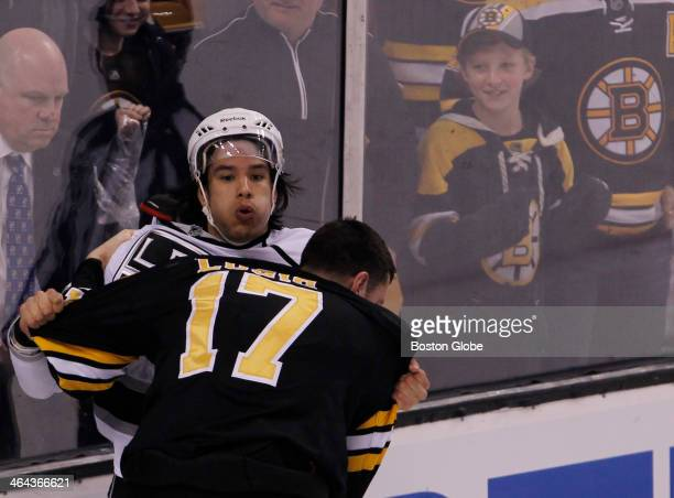 Boston Bruins' Milan Lucic right fights with Los Angeles Kings Jordan Nolan during the first period of play at TD Garden in Boston Jan 20 2014