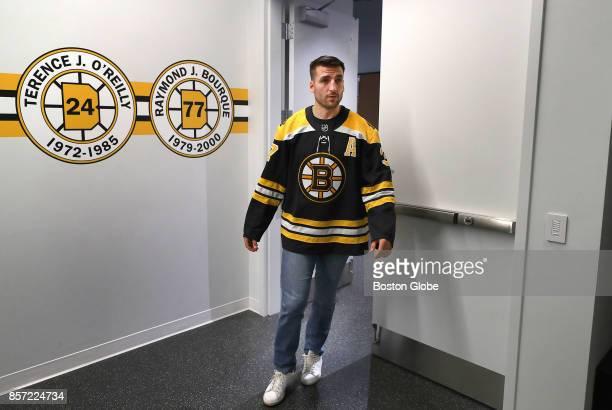 Boston Bruins Patrice Bergeron walks through the locker room door during media day at the Warrior Ice Arena in Boston Oct 3 2017