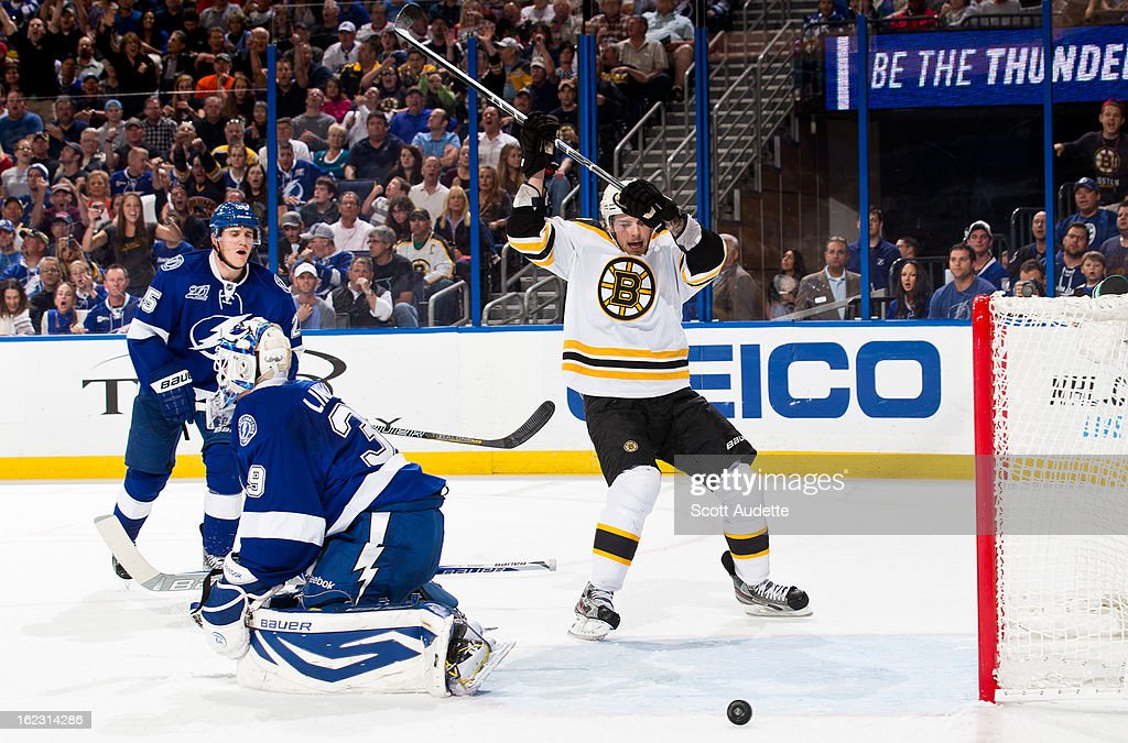 A Boston Bruins player celebrates after a goal scored by <a gi-track='captionPersonalityLinkClicked' href=/galleries/search?phrase=Brad+Marchand&family=editorial&specificpeople=2282544 ng-click='$event.stopPropagation()'>Brad Marchand</a> #63 during the game against the Tampa Bay Lightning at the Tampa Bay Times Forum on February 21, 2013 in Tampa, Florida.
