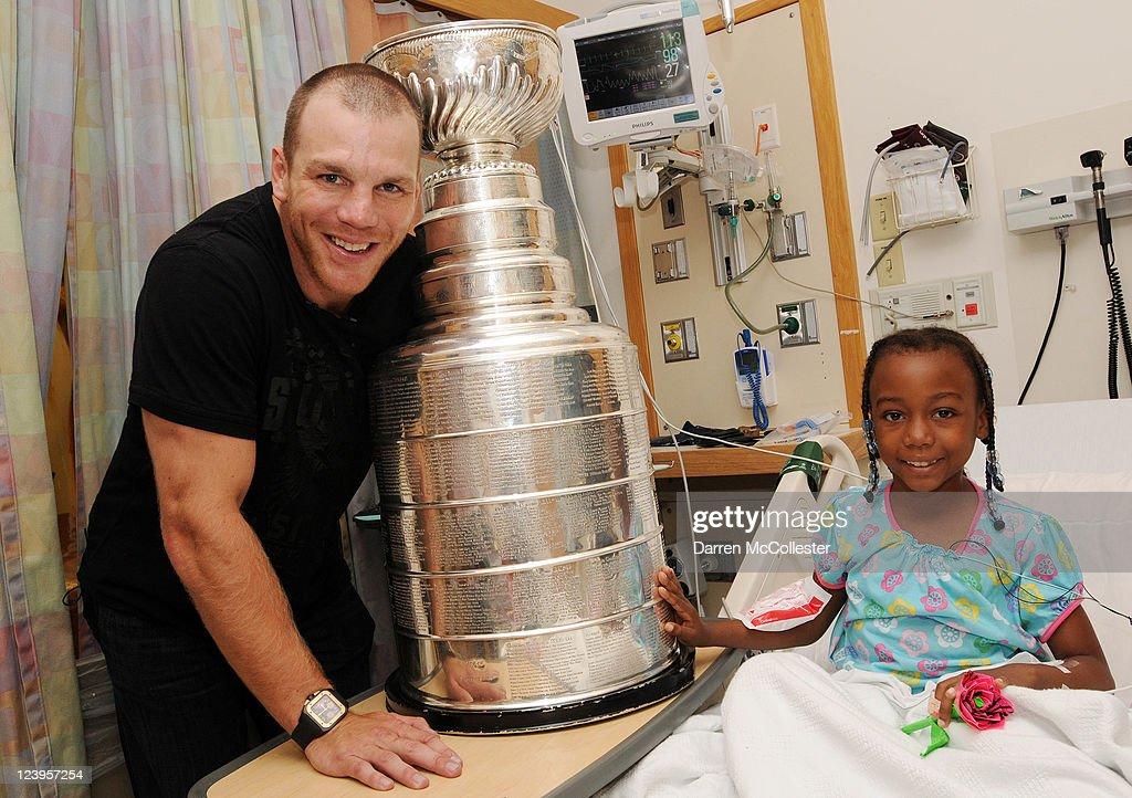 Boston Bruins player Shawn Thornton (L) brings the Stanley Cup to Jayda at Children's Hospital Boston on September 6, 2011 in Boston, Massachusetts.