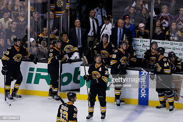 Boston Bruins players look up at the scoreboard as Colorado Avalanche center Daniel Briere's last second goal against the Bruins was ruled good...