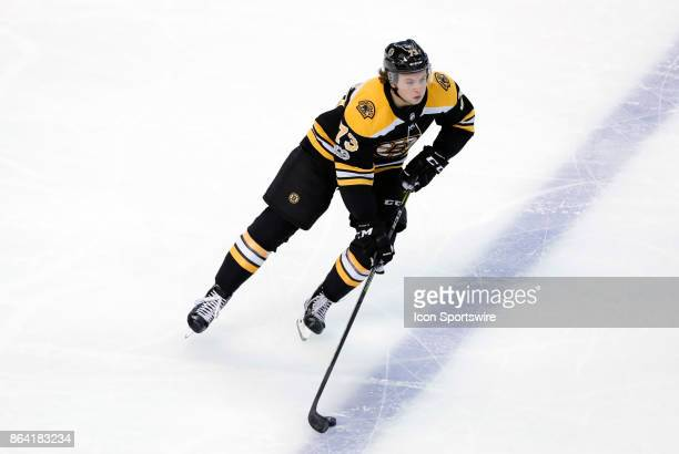 Boston Bruins right defenseman Charlie McAvoy gains the blue line during a game between the Boston Bruins and the Vancouver Canucks on October 19 at...