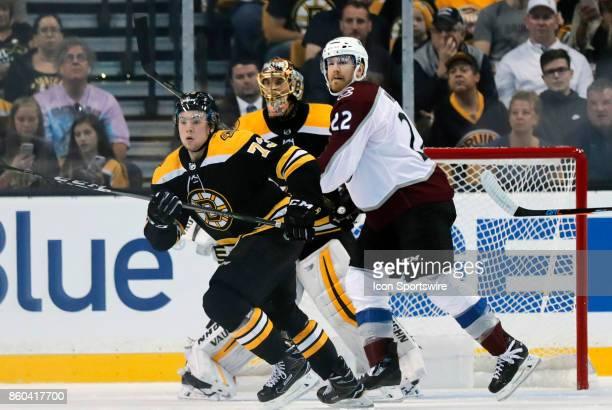 Boston Bruins right defenseman Charlie McAvoy moves to the play with Colorado Avalanche right wing Colin Wilson in front of Boston Bruins goalie...