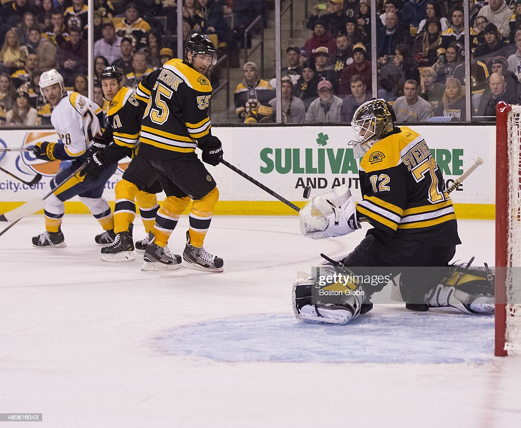 Boston Bruins rookie goalie Chad Johnson makes a glove save during his first NHL start against the Nashville Predators during second period action at TD Garden on Thursday, Jan. 2, 2014.