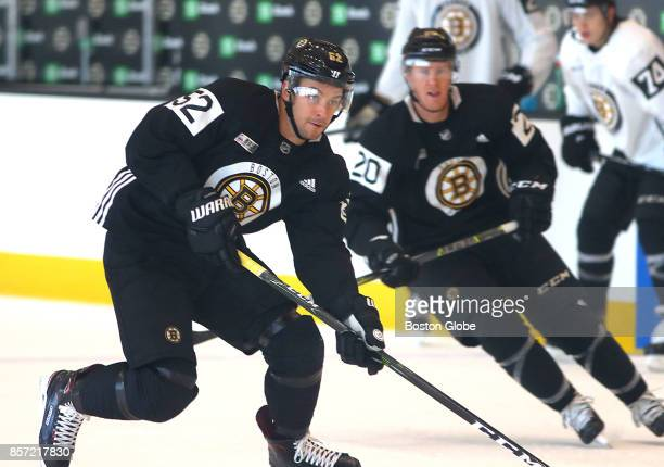 Boston Bruins Sean Kuraly left chases the puck with Riley Nash right during practice and media day at the Warrior Ice Arena in Boston Oct 3 2017