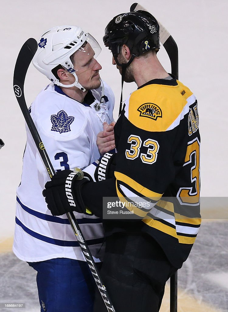 BOSTON, MA - MAY 13 - Boston Bruins Zdeno Chara and Dion Phaneuf shake hands in the first overtime period as the Toronto Maple Leafs play the Boston Bruins in game 7 in their first round NHL Stanley Cup playoffs series at TD Garden in Boston, May 13, 2013.