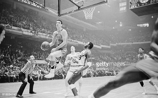 Bulls' Jerry Sloan takes to the air as he goes in for lay up 4th quarter action 1st game of doubleheader Boston Garden Celtics played Warriors in...