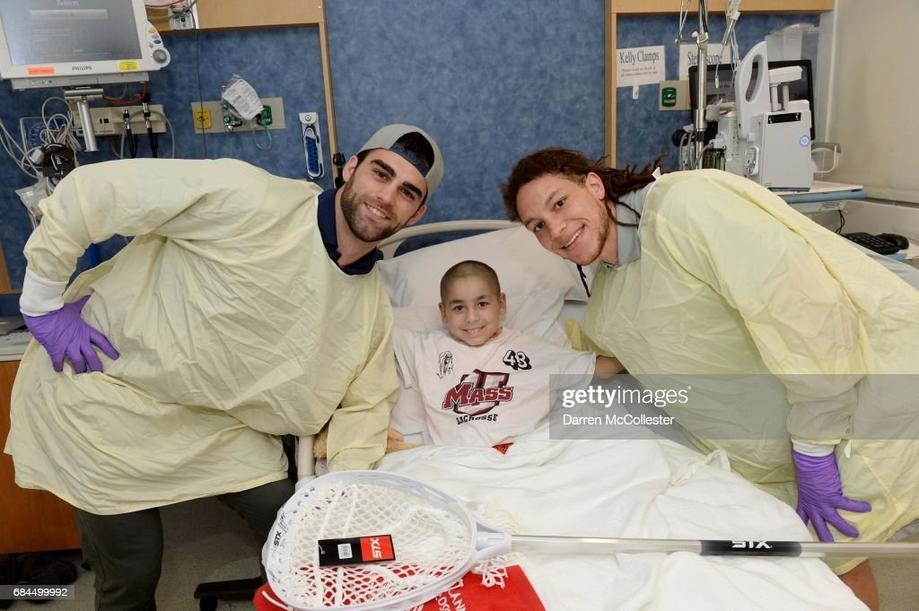 Boston Cannons (L to R) James Fahey, and Josh Hawkins visit Mateo at Boston Children's Hospital on May 18, 2017 in Boston, Massachusetts.