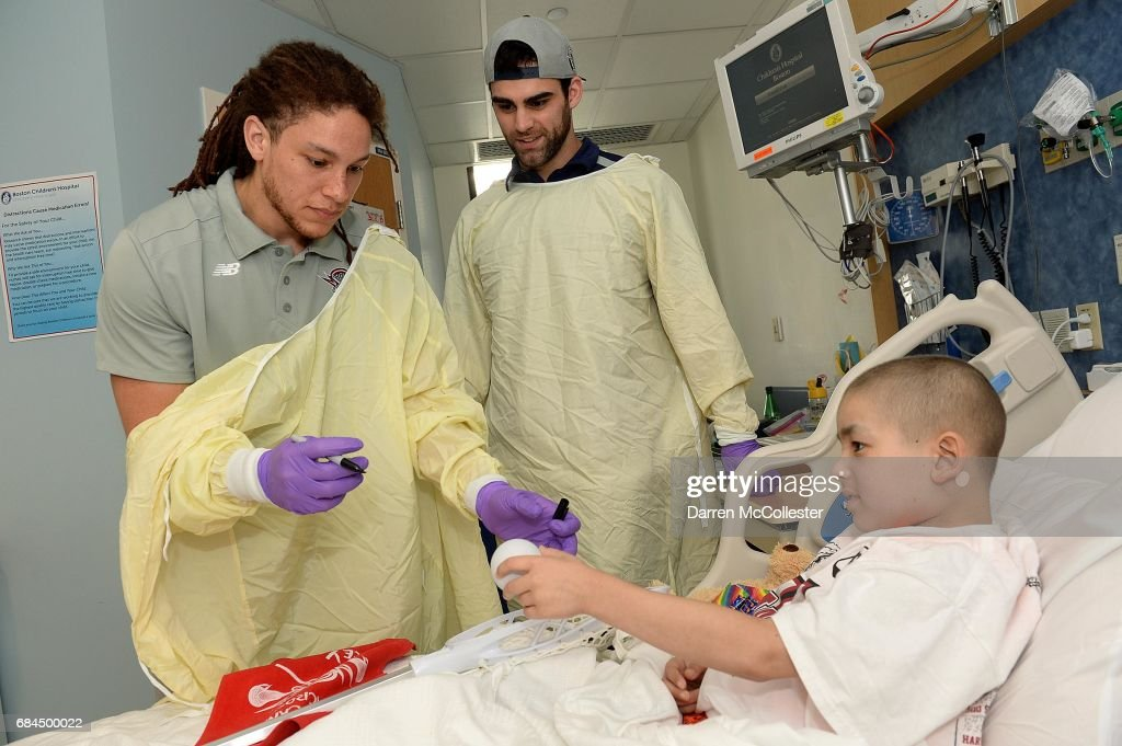 Boston Cannons (L to R) Josh Hawkins, and James Fahey visit Mateo at Boston Children's Hospital on May 18, 2017 in Boston, Massachusetts.